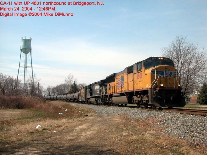 CA-11 with UP unit leading northbound at Bridgeport, NJ.